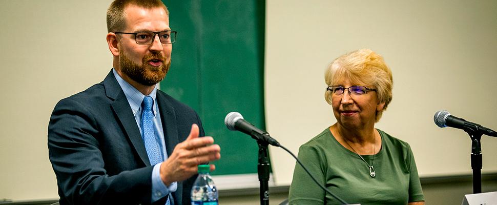 Dr. Kent Brantly, left, speaks at Emory University Hospital as Nancy Writebol listens on Friday, Aug. 2, 2019, in Atlanta.
