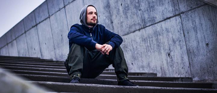Man sitting on stairs.