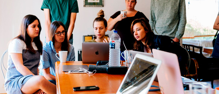 Group of women watching on laptop